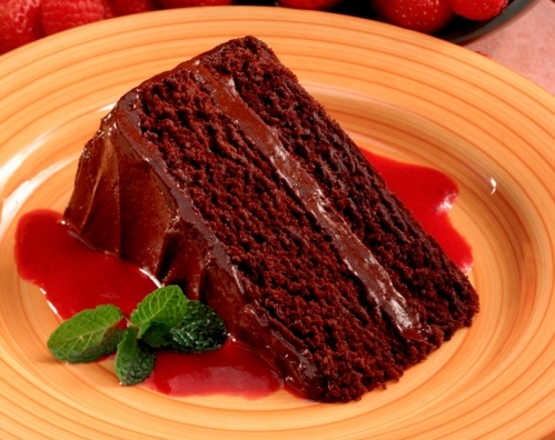 Chocolate cake with strawberry sauce
